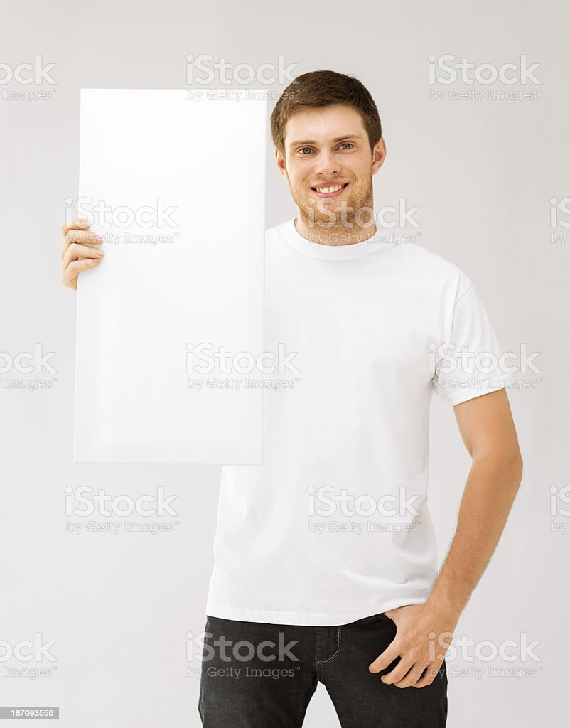 young man holding white blank board royalty-free stock photo