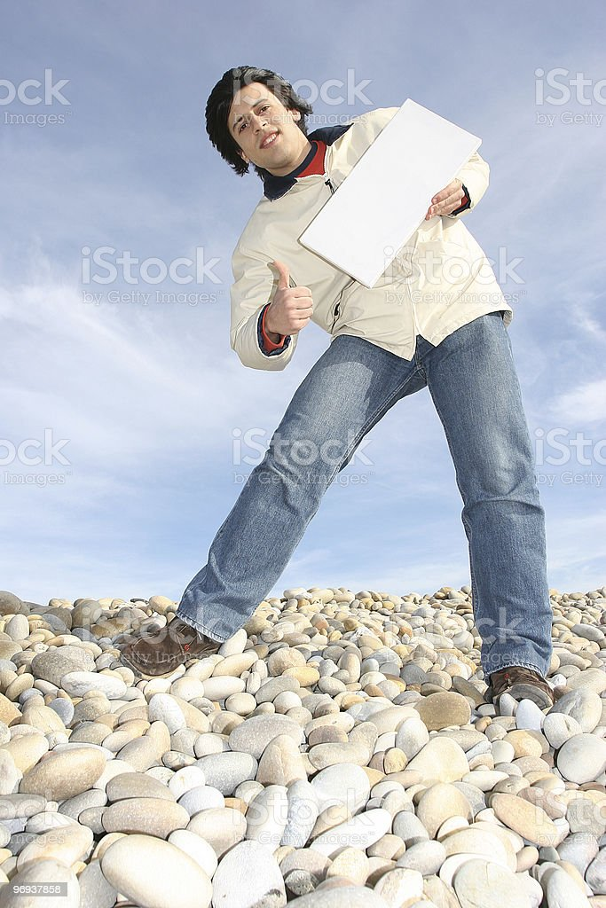 Young Man Holding White Card at the beach royalty-free stock photo