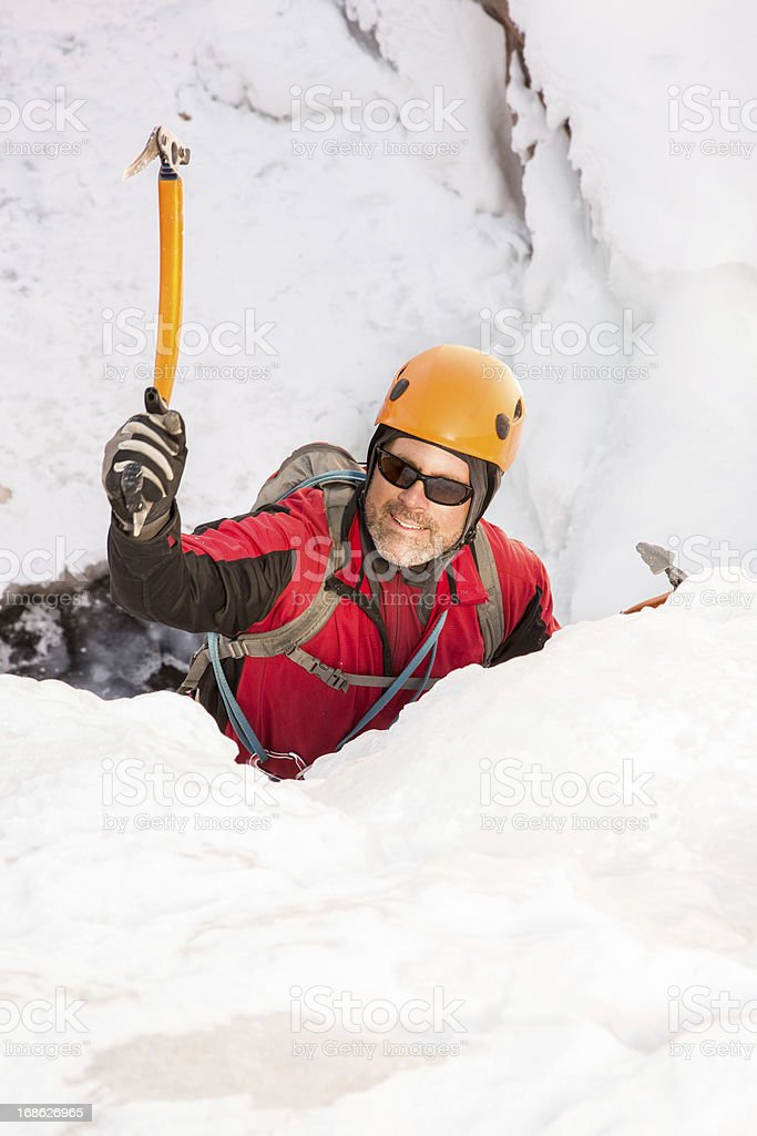 Young Man Ice Climbing royalty-free stock photo