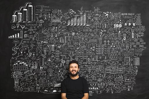 istock Young man Idea Concept on blackboard 845387090