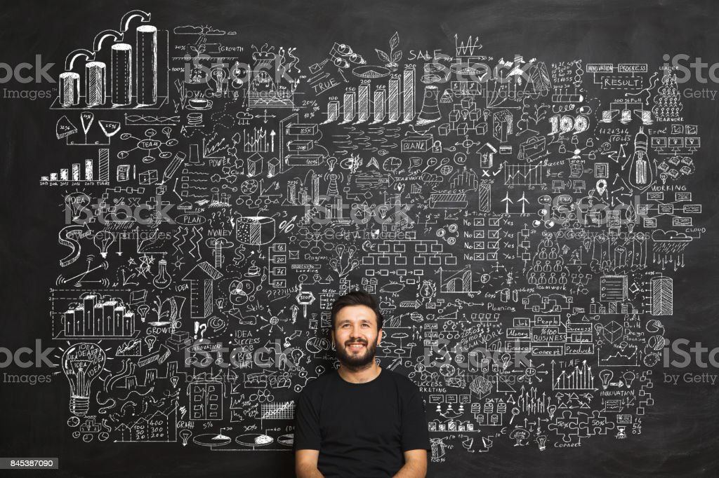 Young man Idea Concept on blackboard stock photo