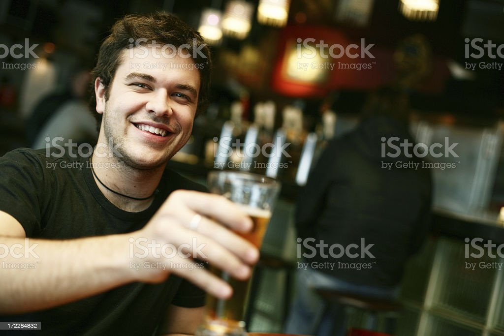 Young man in a bar royalty-free stock photo