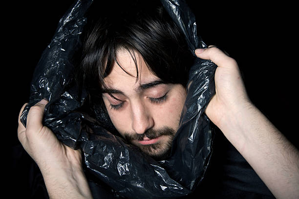 Young man in a body bag stock photo
