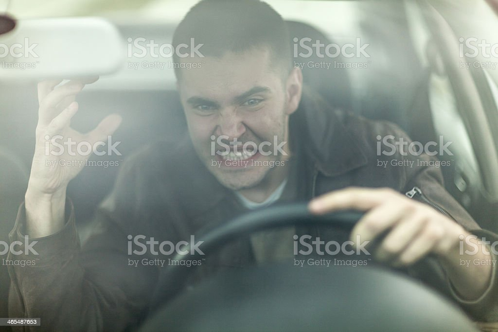 Young man in a car annoyed with traffic stock photo