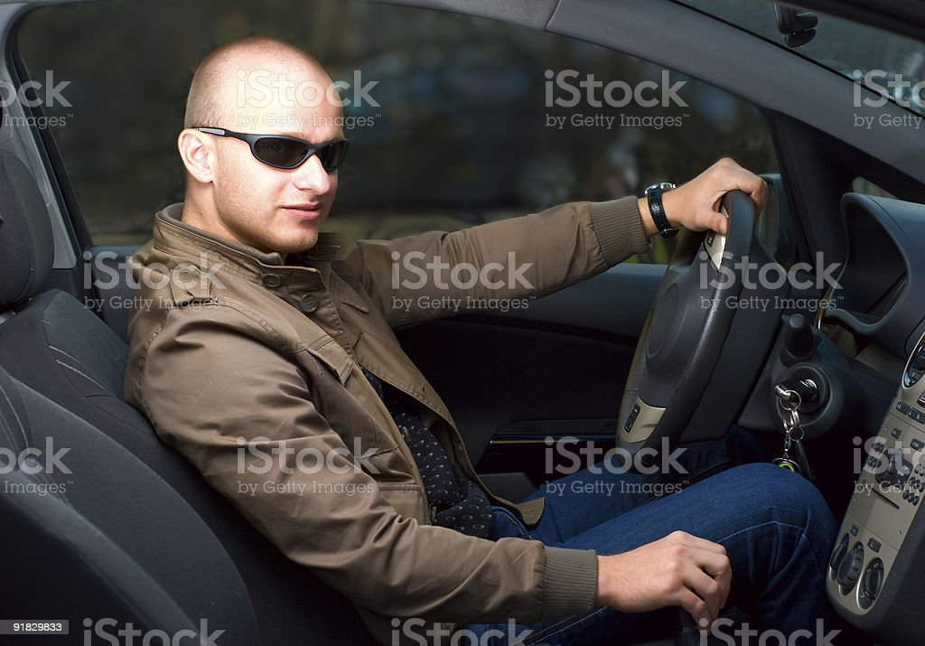 young man in a car royalty-free stock photo