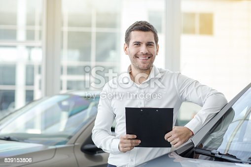 istock Young Man in a Car Rental Service Transportation Concept 839153806