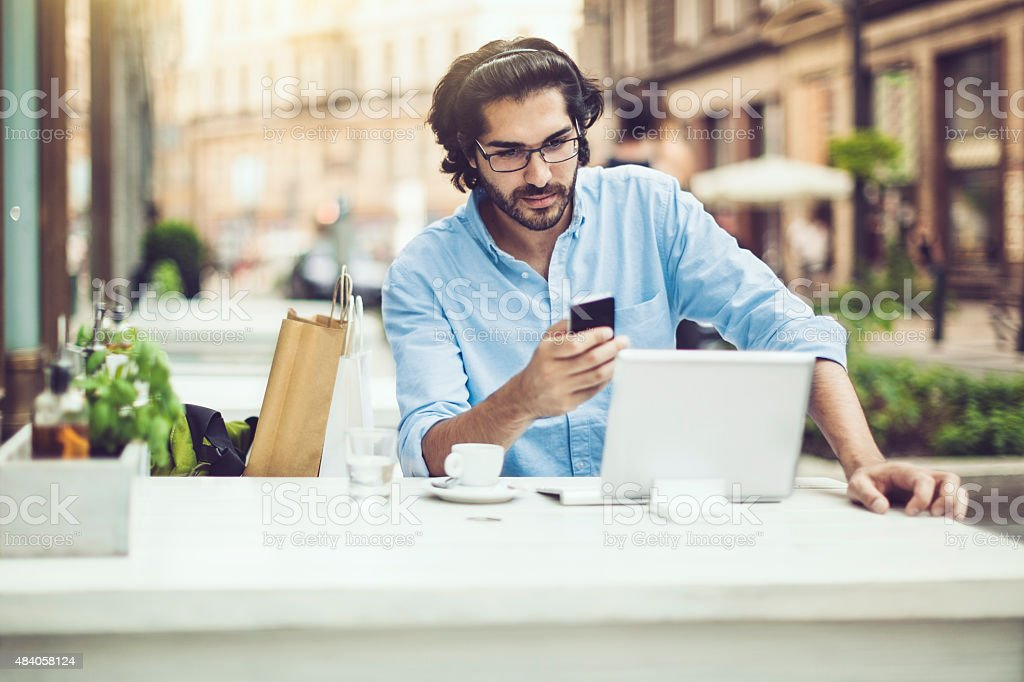 Young man in a coffee shop stock photo