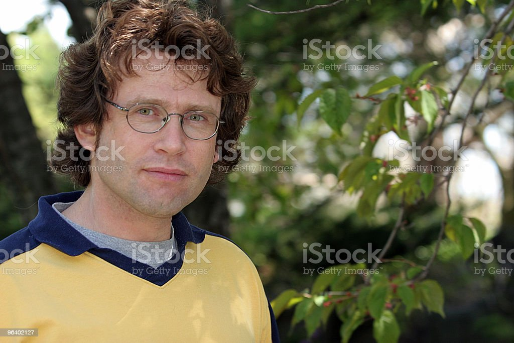 Young man in a forest - Royalty-free Adult Stock Photo