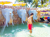 Young man in a hotel pool on Pakarang Beach