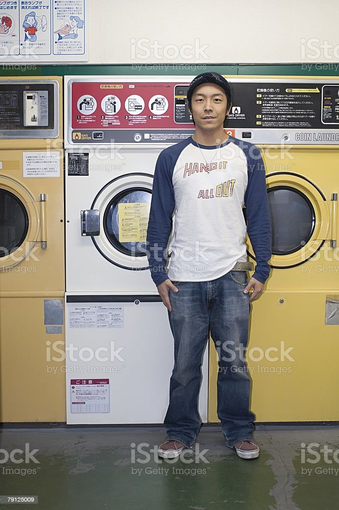 Young man in a laundrette royalty-free 스톡 사진