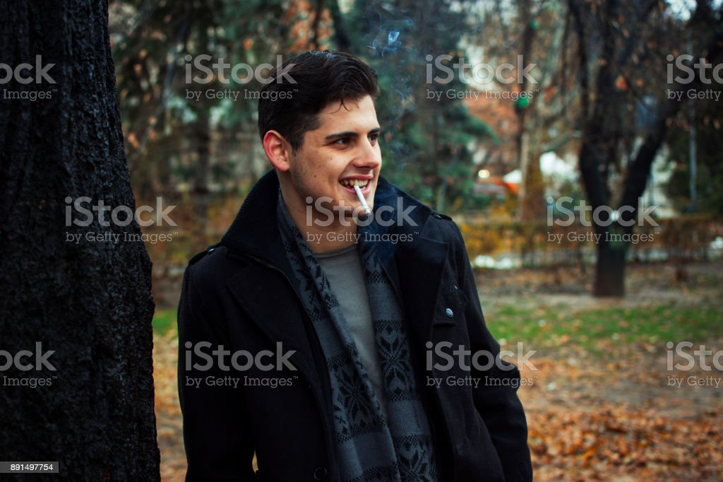 Young man in a public park stock photo