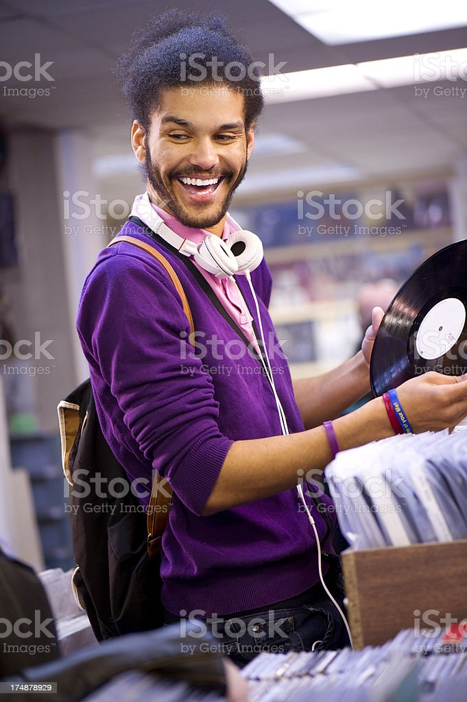 young man in a record shop royalty-free stock photo