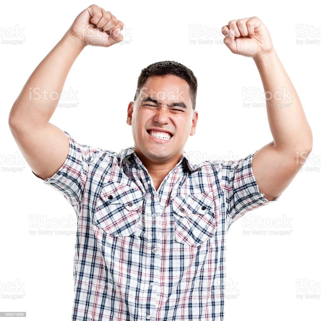 A young man in a short-sleeved plaid shirt raises his fists stock photo