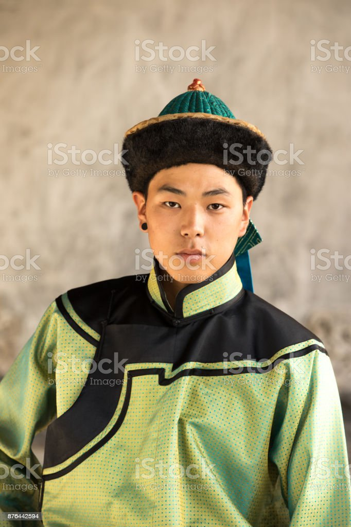 Young man in a traditional Mongolian outfit. stock photo