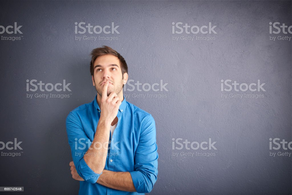 Young man in bad mood stock photo