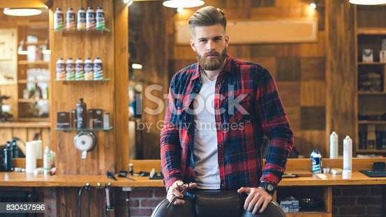 istock Young Man in Barbershop Hair Care Service Concept 830437596