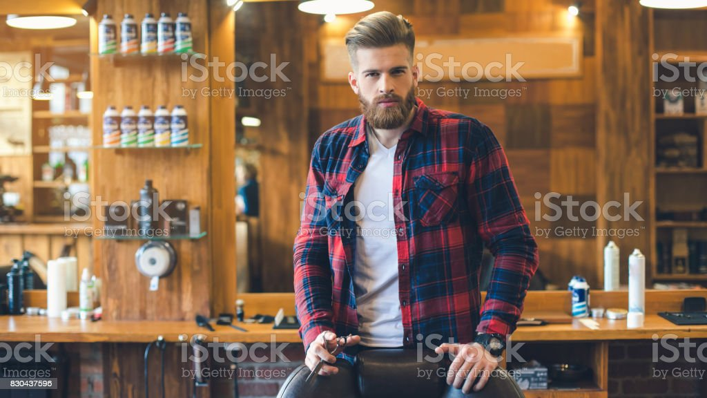 Young Man in Barbershop Hair Care Service Concept stock photo