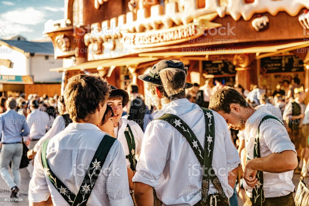 young man in bavarian clothe at oktoberfest in munich stock photo