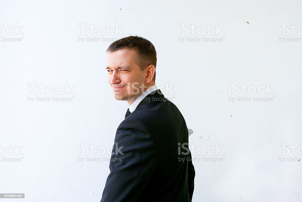 young man in black suit and tie foto royalty-free