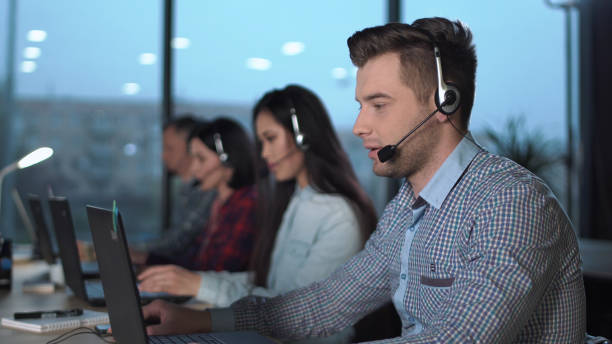 Young man in call center stock photo