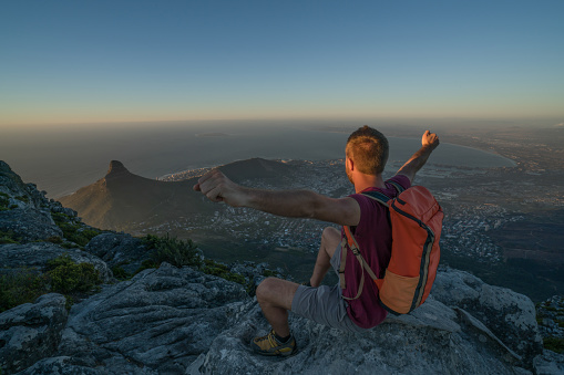 Young Man In Cape Town On Top Of Mountain Arms