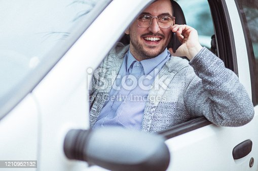 849721378 istock photo Young man in car driving 1210952132