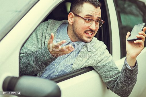 849721378 istock photo Young man in car driving 1210952134