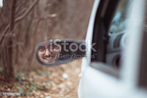 849721378 istock photo Young man in car driving 1210952162