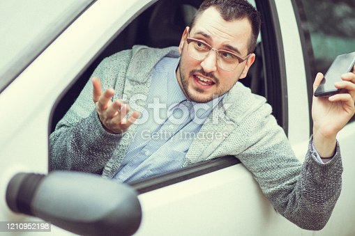 849721378 istock photo Young man in car driving 1210952198