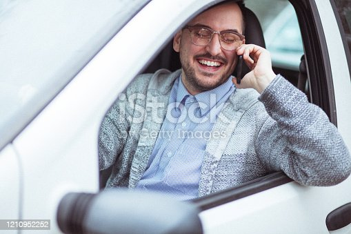 849721378 istock photo Young man in car driving 1210952252