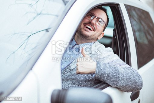 849721378 istock photo Young man in car driving 1210952325