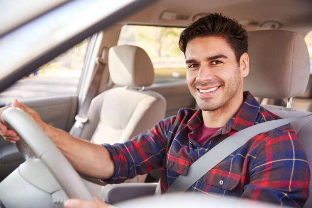 ung man i bil körning seat ser att kamera, porträtt - driving bildbanksfoton och bilder