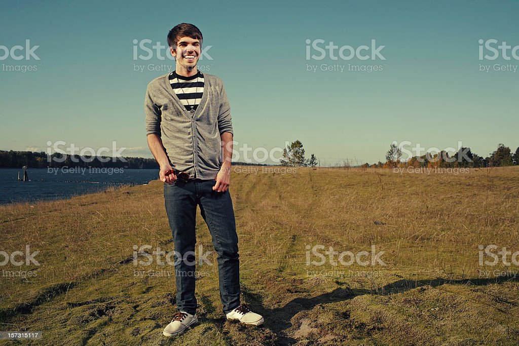 Young Man in Cardigan on River Beach royalty-free stock photo