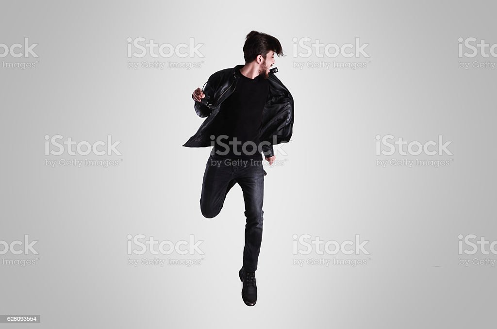Young man in casual clothes is making a high jump – Foto