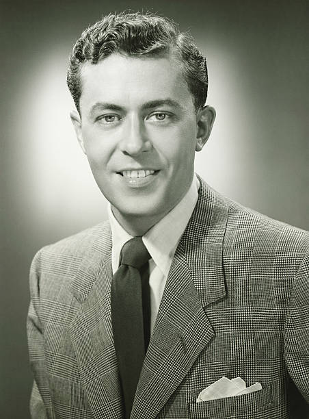 young man in checked jacket posing in studio, (b&w), (close-up), (portrait) - 1950s style stock photos and pictures
