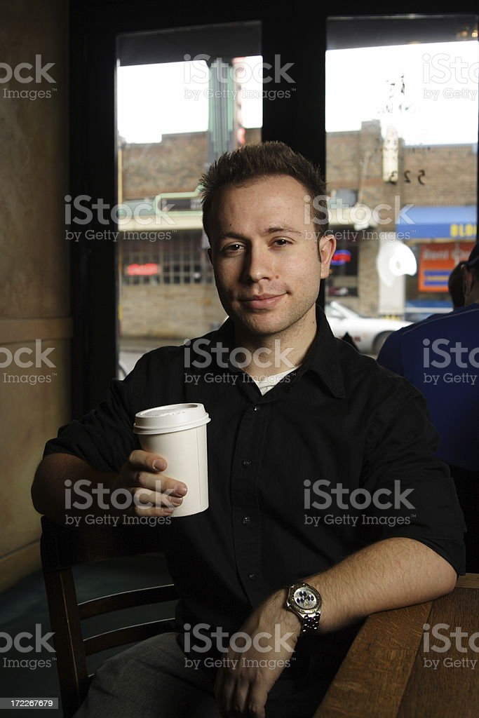 young man in coffee shop downtown royalty-free stock photo