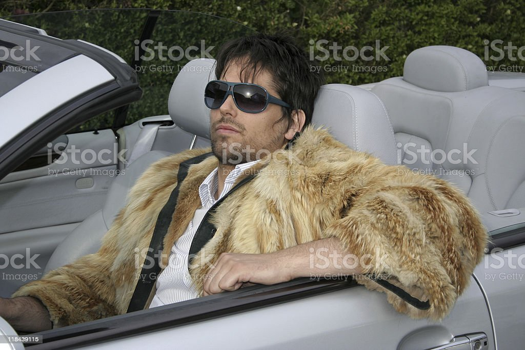 Young man in convertible car stock photo