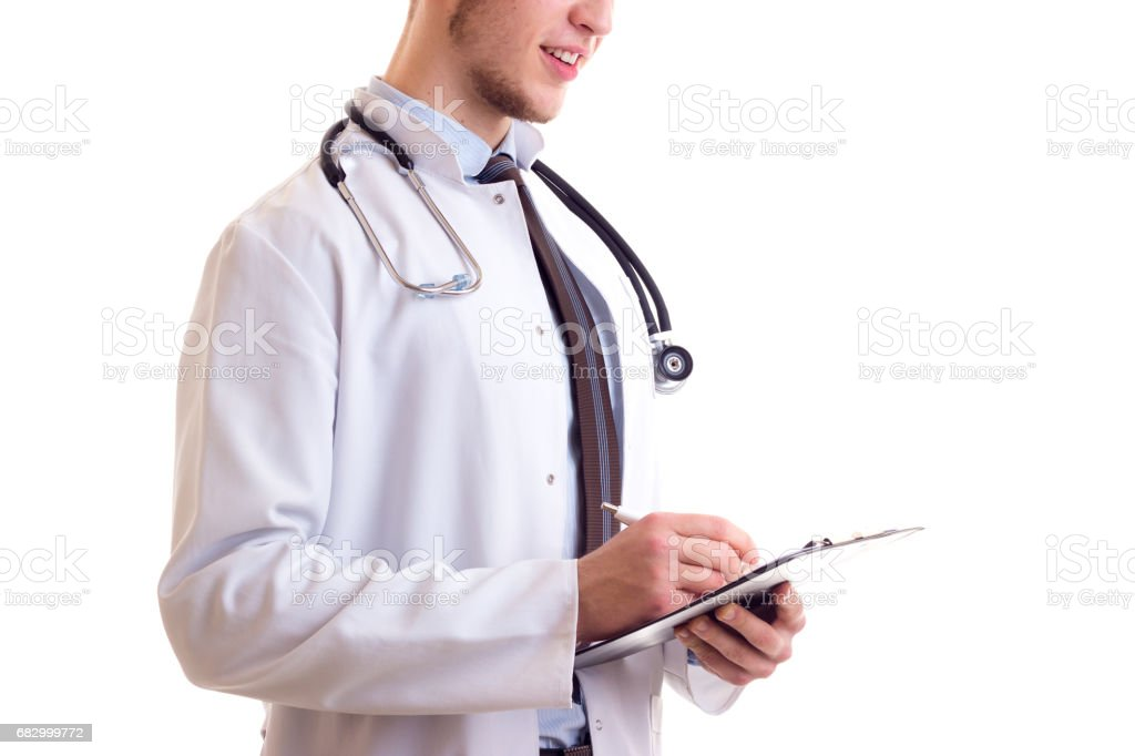 Young man in doctor gown foto de stock royalty-free