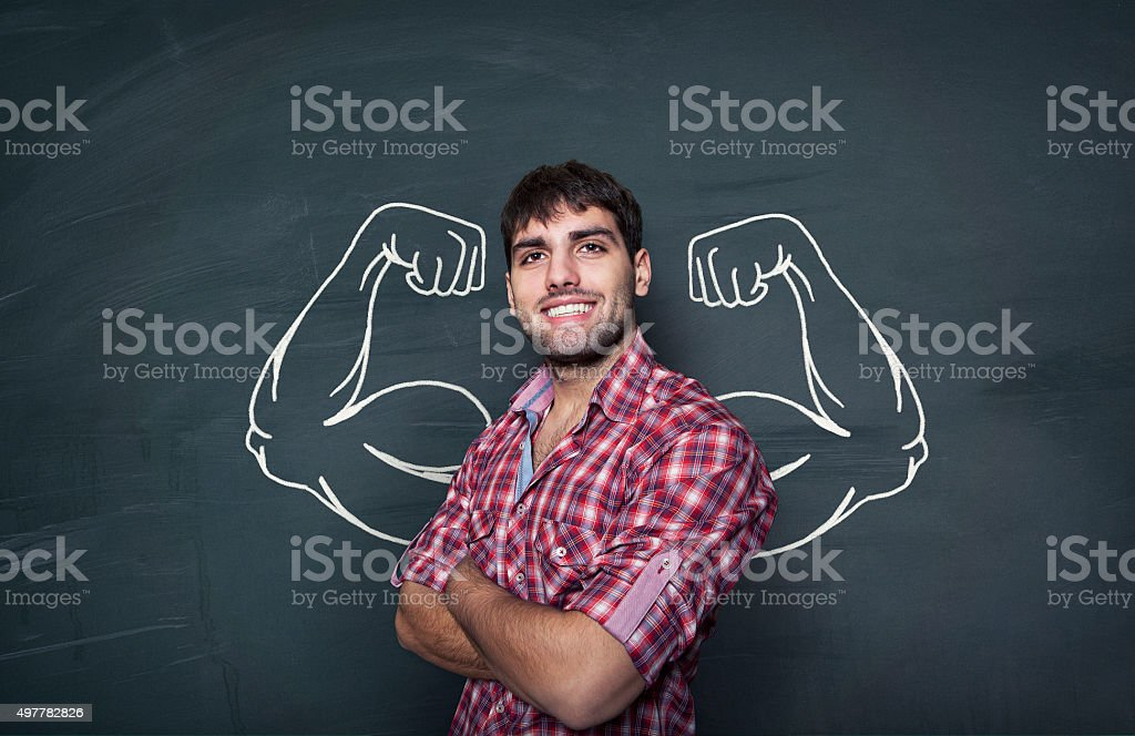 Young man in front of blackboard stock photo