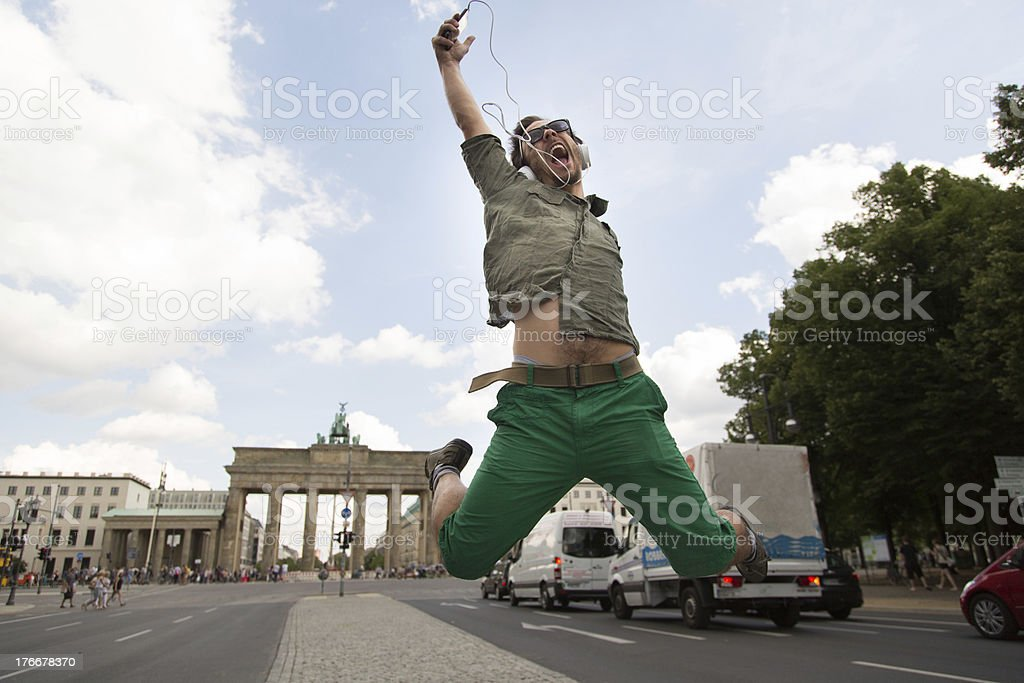 Young man in front of Brandenburg gate royalty-free stock photo