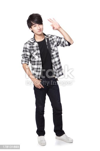 istock young man in full body show ok hand 178131893