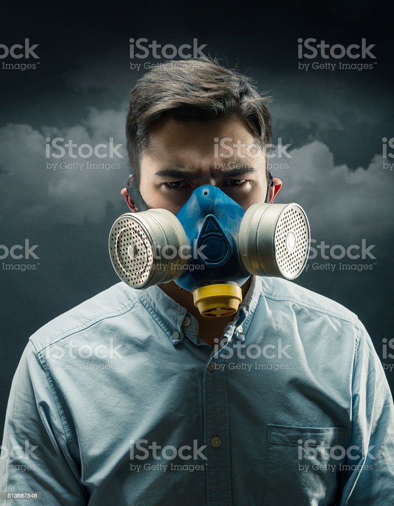 Young man in gas-mask stock photo
