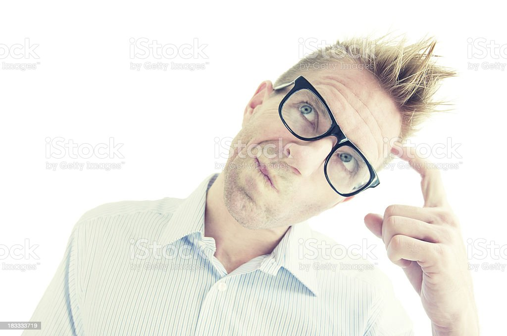Young Man in Glasses Thinking and Scratching Head White Background royalty-free stock photo