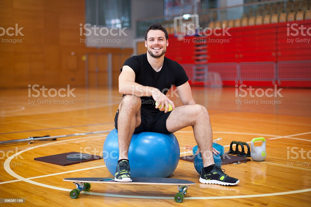 Young Man in Gym Looking at Camera royalty-free stock photo