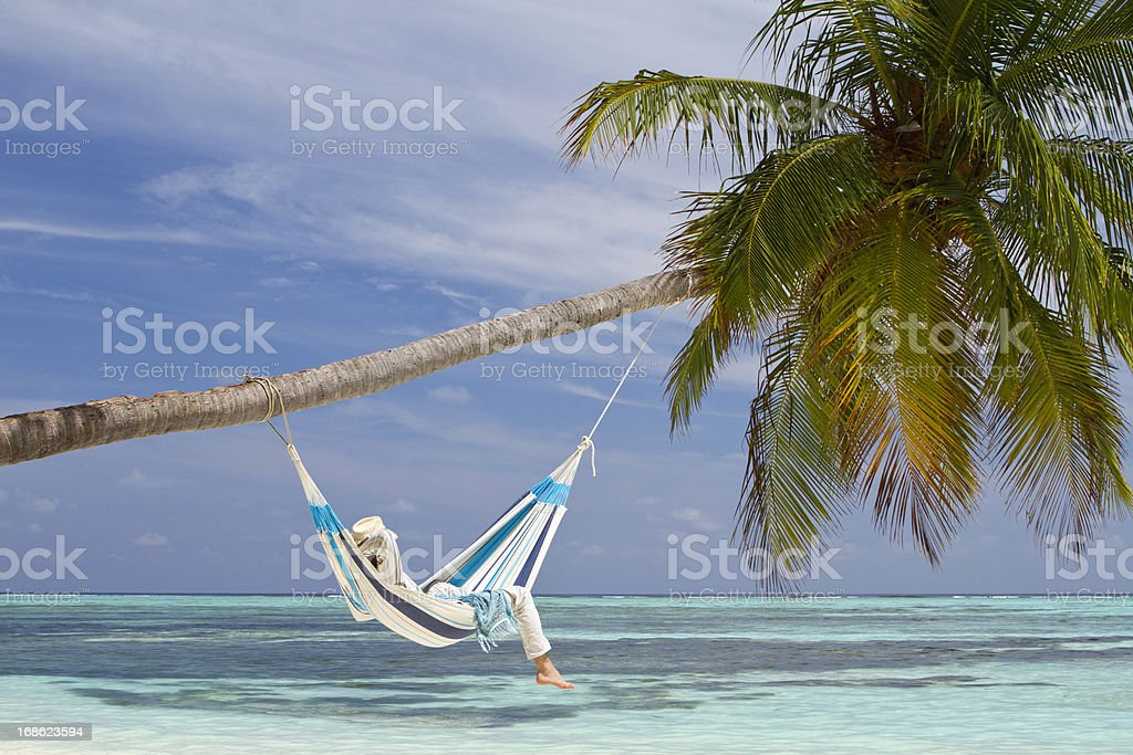 Young man in hammock contemplating the sea royalty-free stock photo