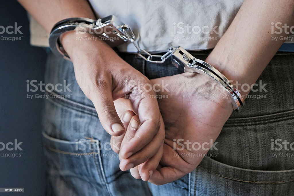 Young man in handcuffs stock photo