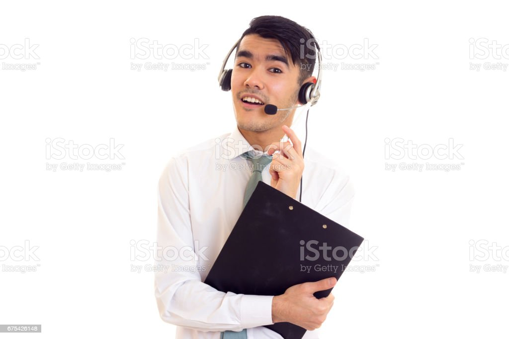 Young man in headphones holding a folder royalty-free stock photo