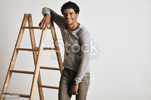 613542420 istock photo Young man in heather grey long sleeve shirt 613544834