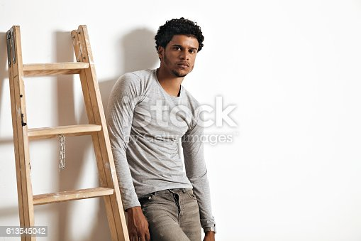 istock Young man in heather grey long sleeve shirt 613545042