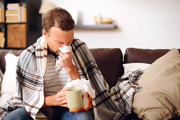 young man in home interior young man in home interior cold virus stock pictures, royalty-free photos & images